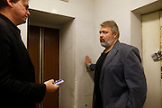 Chief editor Dmitry Muratov at the office of  Novaya Gazeta newspaper in Moscow, talking to Spiegel correspondent Matthias Schepp. Novaya Gazeta is one of the few remaining independent media outlets in Russia that dare to challenge the Kremlin, but it has paid a heavy price for its courage. Anna Politkovskaya, the newspaper's most prominent journalist, was gunned down in her apartment block in Moscow in 2006.   ..Picture by Justin Jin.