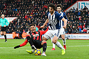 Joshua King (17) of AFC Bournemouth goes down under the challenge of Ahmed Hegazi (26) of West Bromwich Albion during the Premier League match between Bournemouth and West Bromwich Albion at the Vitality Stadium, Bournemouth, England on 17 March 2018. Picture by Graham Hunt.