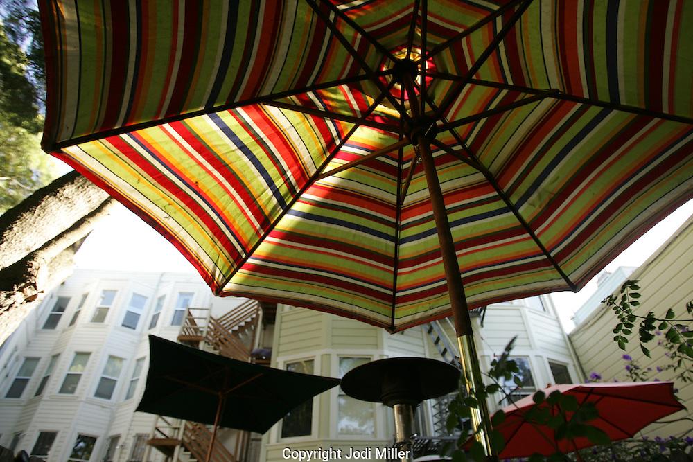 Patio umbrellas at an outdoor cafe.