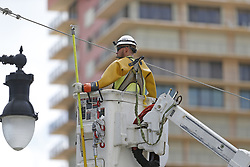 Workers reconnect a main power line at Collins Avenue in the Hurricane Irma aftermath on Tuesday, September 12, 2017, in Sunny Isles Beach, FL, USA Photo by David Santiago/El Nuevo Herald/TNS/ABACAPRESS.COM