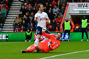 Harry Kane (10) of Tottenham Hotspur foot is trapped and twisted as he is challenged by Asmir Begovic (27) of AFC Bournemouth whe attempting to score but his goal is ruled offside during the Premier League match between Bournemouth and Tottenham Hotspur at the Vitality Stadium, Bournemouth, England on 11 March 2018. Picture by Graham Hunt.