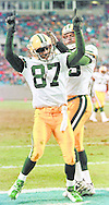 (Published caption 12/15/97) Packers' Robert Brooks celebrates with fellow wide receiver Antonio Freeman after catching a 20-yard touchdown pass in the first quarter.