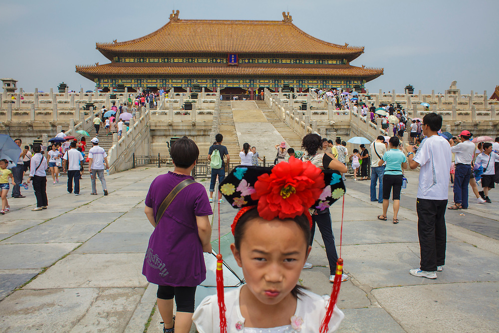 A girl plays inside the Forbidden City in Beijing.