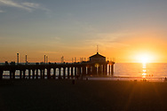 Photo Manhattan Beach sunset wall art. Pier, Orange sky, ocean, beach, waves, sun rays. Matted print, Southbay, Los Angeles, Southern California photography. Fine art photography limited edition.