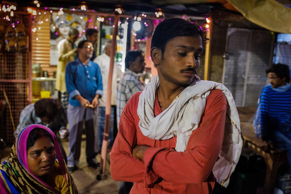 VARANASI, INDIA - CIRCA NOVEMBER 2016: People in the streets of Varanasi early morning.