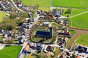 Nederland, Friesland, Gemeente Littenseradeel, 01-05-2013; Jorwerd (Jorwert), dorp met Hervormde kerk met toren en kerkhof (Sint-Radboudkerk). Bekend van het boek van schrijver Geert Mak 'Hoe God verdween uit Jorwerd'.<br /> Small village with church in Friesland (featuring in well known reportage).<br /> luchtfoto (toeslag op standard tarieven)<br /> aerial photo (additional fee required)<br /> copyright foto/photo Siebe Swart