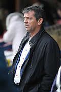Southend United manager Phil Brown  looking onto the pitch during the EFL Sky Bet League 1 match between AFC Wimbledon and Southend United at the Cherry Red Records Stadium, Kingston, England on 1 January 2018. Photo by Matthew Redman.