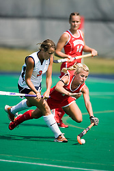 Boston University Terriers M/B Pam Spuehler (4) dives to take the ball away from Virginia Cavaliers B/M Haley Carpenter (3)..The Virginia Cavaliers field hockey team fell to the Boston University Terriers 3-0 at the University Hall Turf Field in Charlottesville, VA on September 23, 2007