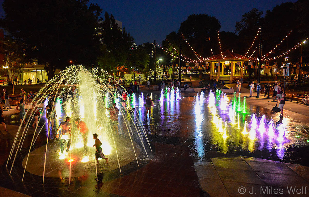 Kids playing in the Washington Park Fountains at night