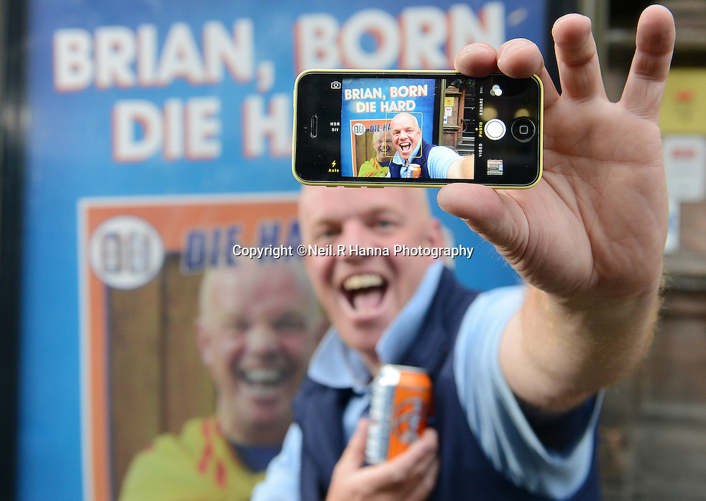 BORN SUPPORTERS WINNER-PERTH<br /> <br /> As part of its support of the Glasgow 2014 Commonwealth Games IRN-BRU, Scotland's 'other national drink', unveiled the Perth winner of the competition who  star in its BORN SUPPORTERS ad campaign, alongside the bus shelter advert that he features in.<br /> The lucky Perth winner is Brian Provan, who's face will appear on bus shelter adverts across the city for the whole of Perth to see.<br /> <br /> Brian Provan photographed at the bus shelter on 14 Kinnoul Street, South of Mill Street, Perth<br /> <br /> <br /> <br /> <br /> Neil Hanna Photography<br /> www.neilhannaphotography.co.uk<br /> 07702 246823