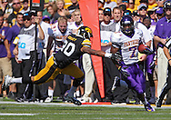 September 15 2012: Iowa Hawkeyes linebacker Christian Kirksey (20) tries to grab Northern Iowa Panthers running back David Johnson (7) during the first quarter of the NCAA football game between the Northern Iowa Panthers and the Iowa Hawkeyes at Kinnick Stadium in Iowa City, Iowa on Saturday September 15, 2012. Iowa defeated Northern Iowa 27-16.