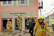 Tinton Falls firefighters survey the damage and look for possible survivors along the storm-ravaged Ocean Avenue in Sea Bright four days after Hurricane Sandy made it's way through the area on November 2. Hurricane Sandy forced the shutdown of mass transit, schools and financial markets, sending coastal residents fleeing for higher ground, and threatened a dangerous mix of high winds and soaking rain.