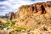View of Picnic Lunch Wall and Red Wall from the North Point Trail across the Crooked River in Smith Rock State Park, Oregon.
