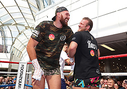 Tyson Fury (left) and trainer Ben Davison during the public workout at Castle Court Shopping Centre, Belfast.