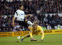 Photo: Kevin Poolman.<br />Derby County v Sheffield Wednesday. Coca Cola Championship. 13/01/2007. Dean Burton of Wednesday gets a kick in the head from Derby's Dean Leacock.