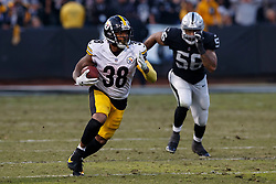 OAKLAND, CA - DECEMBER 09: Running back Jaylen Samuels #38 of the Pittsburgh Steelers rushes up field against the Oakland Raiders during the fourth quarter at the Oakland Coliseum on December 9, 2018 in Oakland, California. The Oakland Raiders defeated the Pittsburgh Steelers 24-21. (Photo by Jason O. Watson/Getty Images) *** Local Caption *** Jaylen Samuels