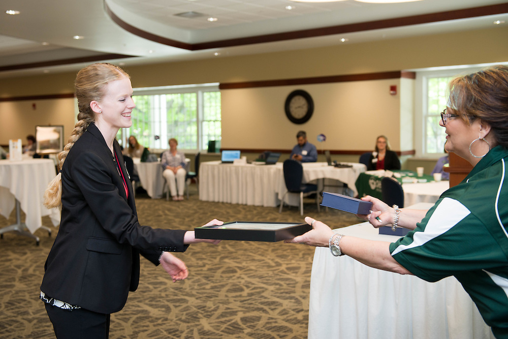 Tasha Gardone, Marketing and Design Specialist in the Office of Student Affairs, recieves the Excellence in Marketing and Branding - Campaign award at the Campus Communicator Network Expo in Nelson Commons on Wednesday, May 11, 2016. © Ohio University / Photo by Kaitlin Owens