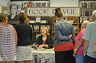 Huntington, New York, U.S. - August 6, 2014 - Hillary Rodham Clinton speaks with many people at the book signing event promoting her new memoir, Hard Choices, at Book Revue in Huntington, Long Island, during a nationwide tour. Clinton's book is about her four years as America's 67th Secretary of State and how they influence her view of the future.