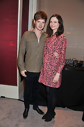 SOPHIE ELLIS-BEXTOR and RICHARD JONES at a reception to unveil the ISAF World Match Racing Tour Championship Trophy at Garrard, 24 Albemarle Street, London W1 on 7th November 2011.