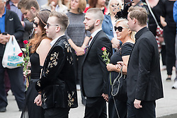 © Licensed to London News Pictures . 30/06/2017 . Stockport , UK . Mourners outside the Town Hall . The funeral of Martyn Hett at Stockport Town Hall . Martyn Hett was 29 years old when he was one of 22 people killed on 22 May 2017 in a murderous terrorist bombing committed by Salman Abedi, after an Ariana Grande concert at the Manchester Arena . Photo credit : Joel Goodman/LNP