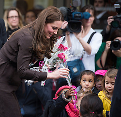 16/01/2015. London, UK. The Duchess of Cambridge being greeted by young children who gave her flowers as she leaves The Fostering Network in North London where she attended an event to celebrate the work of foster carers in providing support to vulnerable young people. Photo credit: Ben Cawthra
