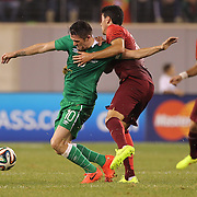 Robbie Keane, Ireland, is tackled by André Almeida, Portugal, during the Portugal V Ireland International Friendly match in preparation for the 2014 FIFA World Cup in Brazil. MetLife Stadium, Rutherford, New Jersey, USA. 10th June 2014. Photo Tim Clayton