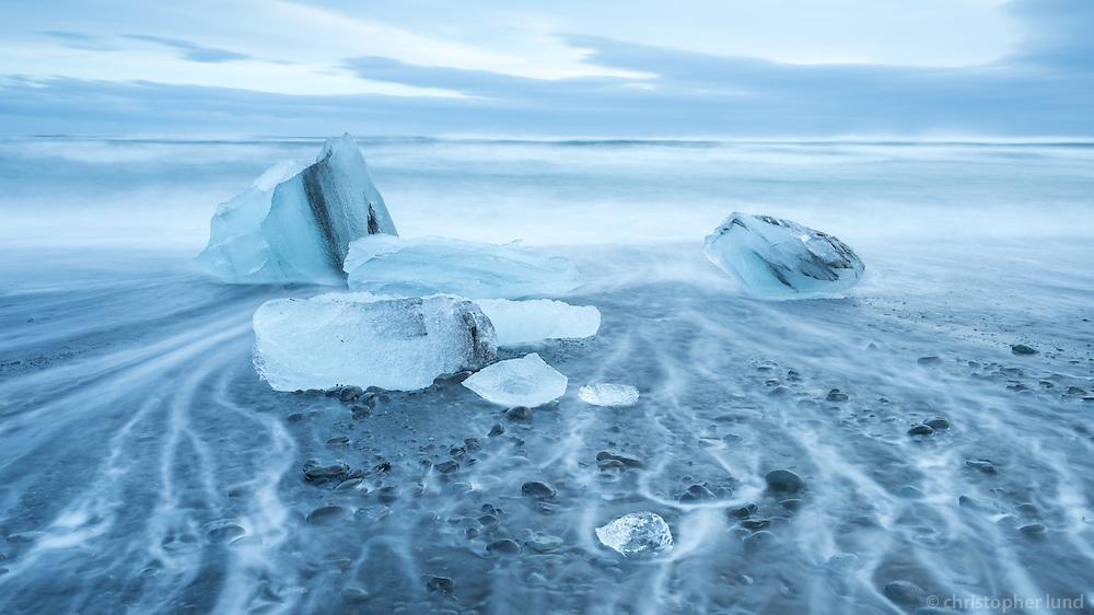 Icebergs melting away at Jökulsárlón glacial lagoon beach. Southeast Iceland.