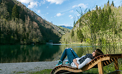 THEMENBILD - eine Frau genießt die Sonnenstrahlen auf einer Holzliege, aufgenommen am 24. April 2017, Klammsee, Kaprun Österreich // A woman enjoys the sun rays on a wood lounger at the Klammsee, Kaprun Austria on 2017/04/24. EXPA Pictures © 2017, PhotoCredit: EXPA/ JFK