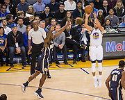 Golden State Warriors guard Stephen Curry (30) shoots a three pointer against the Indiana Pacers at Oracle Arena in Oakland, Calif., on December 5, 2016. (Stan Olszewski/Special to S.F. Examiner)