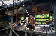 Mentawai indigenous man at house (Indonesia).