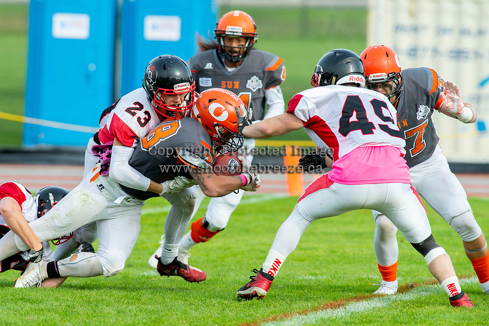 KELOWNA, BC - OCTOBER 6: Blake Johnson #23 of the VI Raiders tackles Kelton Kouri #38 of Okanagan Sun as he runs with the ball at the Apple Bowl on October 6, 2019 in Kelowna, Canada. (Photo by Marissa Baecker/Shoot the Breeze)