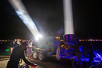 One of my favorite experiences this burn was controlling these 500AMP spotlights wirelessly using a tablet. You drag your finger across the tablet screen and the spotlights move accordingly. Also these folks let me put on welders glasses so I could stick my face in front of the beam and see the arc light. It was scary as hell and my face got hot very fast but damn was it incredible! Thank you! (These we're previously military spotlights that would have infrared beams so the battlefield would be illuminated to soldiers wearing infrared goggles... In that situation the beams were invisible to the enemy.)<br /> <br /> <br /> <br /> Project Flashlight<br /> by: Neal Strickberger<br /> from: San Francisco, CA<br /> year: 2019<br /> <br /> Project flashlight is the joy of light at grand scale.<br /> <br /> Pure, incredibly bright white beam-like fingers of God in the dust, contrast with the night sky, scale across the open playa, interplay of beams, light in motion.<br /> <br /> Military/NASA billion-candlepower searchlights, reanimated for art! Interactive with tablet controls.<br /> <br /> URL: http://projectflashlight.org<br /> Contact: info@projectflashlight.org<br /> <br /> https://burningman.org/event/brc/2019-art-installations/?yyyy=&artType=B#a2I0V000001AY00UAG