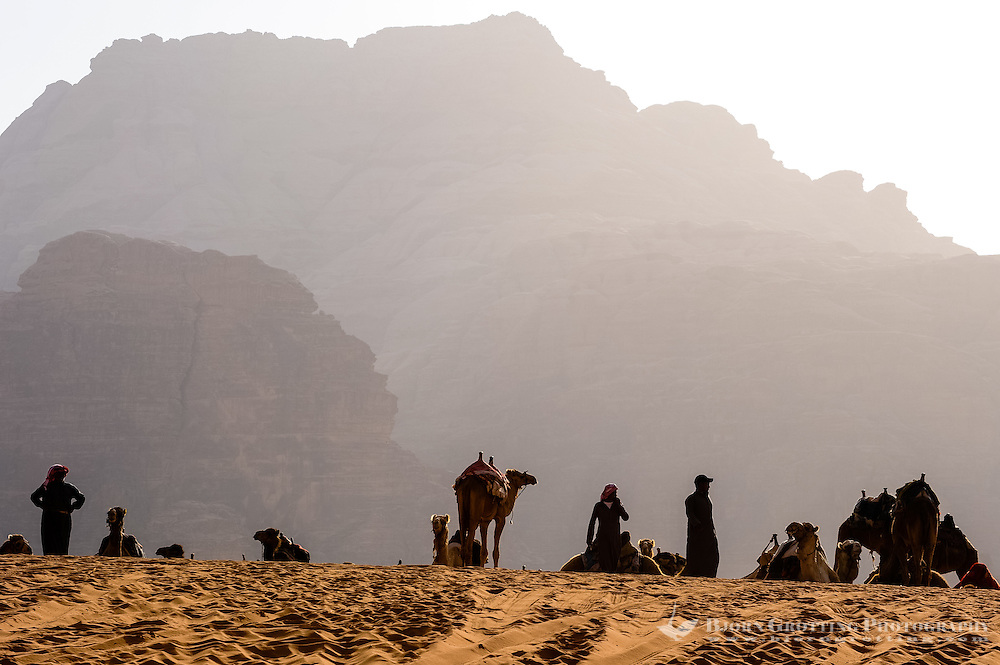 Jordan. Wadi Rum is also known as The Valley of the Moon. Bedouins welcoming tourists to a dromedariy ride.