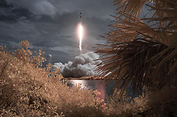 In this photo released by the National Aeronautics and Space Administration (NASA), A SpaceX Falcon 9 rocket carrying the company's Crew Dragon spacecraft is seen in this false color infrared exposure as it is launched on NASA's SpaceX Demo-2 mission to the International Space Station with NASA astronauts Robert Behnken and Douglas Hurley onboard, Saturday, May 30, 2020, at NASA's Kennedy Space Center in Florida. The Demo-2 mission is the first launch with astronauts of the SpaceX Crew Dragon spacecraft and Falcon 9 rocket to the International Space Station as part of the agency's Commercial Crew Program. The test flight serves as an end-to-end demonstration of SpaceX's crew transportation system. Behnken and Hurley launched at 3:22 p.m. EDT on Saturday, May 30, from Launch Complex 39A at the Kennedy Space Center. A new era of human spaceflight is set to begin as American astronauts once again launch on an American rocket from American soil to low-Earth orbit for the first time since the conclusion of the Space Shuttle Program in 2011. Photo by Bill Ingalls / NASA via CNP/ABACAPRESS.COM