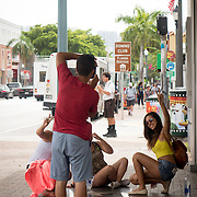 JUNE 9, 2016---MIAMI, FLORIDA<br /> Tourists pose for photos in the heart of Miami's Little Havana neighborhood. The neighborhood has seen a resurgence of out of town visitors who eat latin food, drink coffee and smoke cigars, among other things.<br /> (Photo by Angel Valentin/Freelance)