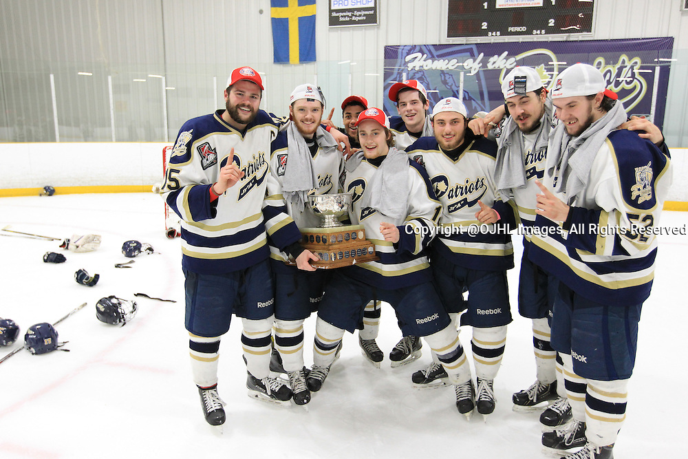 TORONTO, ON - Apr 22, 2015 : Ontario Junior Hockey League game action between the Toronto Patriots and the Kingston Voyageurs. Game seven of the Buckland Cup Championship Series. Toronto Patriots players pose with the Cup.<br /> (Photo by Tim Bates / OJHL Images)