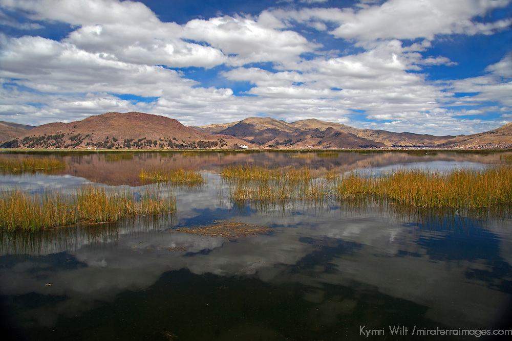 South America, Peru, Lake Titicaca. Clouds and reflections on Lake Titicaca near Puno.