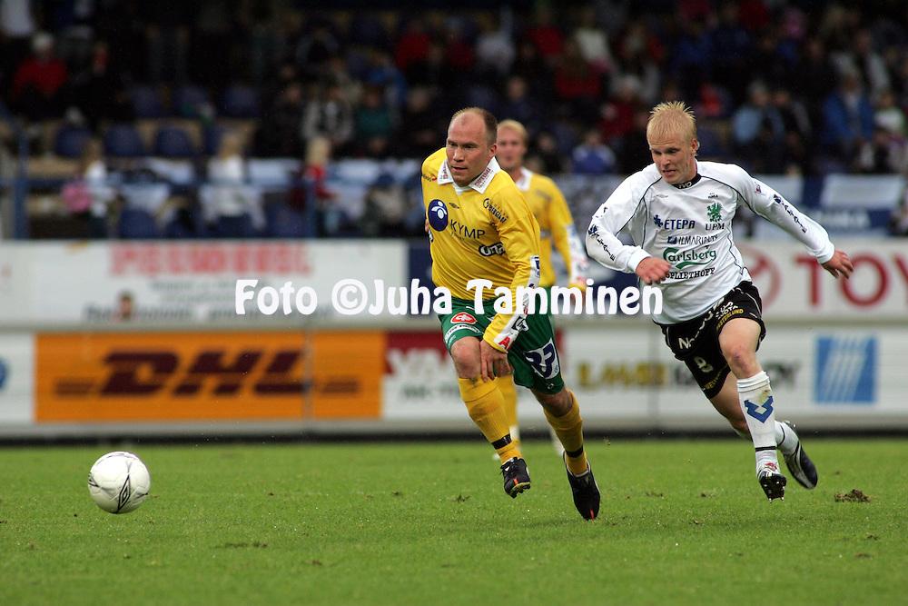 28.08.2005, Tehtaankentt?, Valkeakoski, Finland..Veikkausliiga 2005 / Finnish League 2005.FC Haka v FC KooTeePee.Liivo Leetma (KooTeePee) v Jani Kauppila (Haka).©Juha Tamminen.....ARK:k