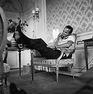 Feet up, relaxing, Harry Belafonte in his suite in the Hotel Raphael in Paris.<br />