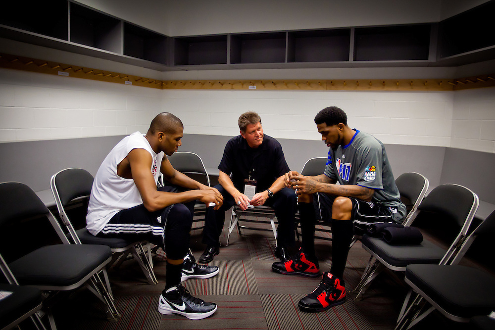 MIAMI, FL -- January 29, 2012 -- Pastor Steve DeBardelaben prays with Miami players James Jones, left, and Udonis Haslem before taking the court before the 97-93 Heat win over the Chicago Bulls at American Airlines Arena in Miami, Fla., on Sunday, January 29, 2012.  (Chip Litherland for ESPN the Magazine)