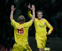 London, England - Tuesday, January 30, 2007: Liverpool's Peter Crouch celebrates scoring the second goal against West Ham United with team-mate a fellow scorer Dirk Kuyt during the Premiership match at Upton Park. (Pic by David Rawcliffe/Propaganda)..USE IN LIVERPOOL DAILY POST & ECHO, LFC MAGAZINE & LFC PROGRAMME ONLY. NOT FOR OTHER USE.