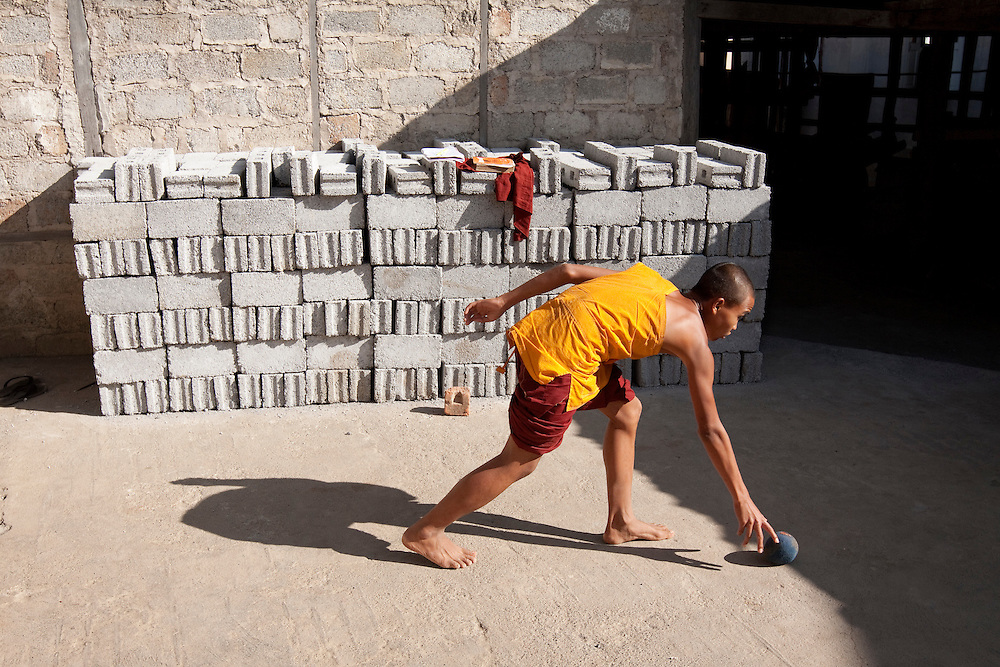 Novice monks finish a game of soccer at Swhe Gu Kyaung monastery in Nyaung Swhe near Inle lake in central Myanmar.