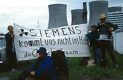CZECH REPUBLIC:TEMELIN:JUL97 - A German activist group, Die Gorlebenfrauen from the nuclear depository in Gorleben, display banners at Czech nuclear power plant Temelin. Despite vehement and sustained protests from both environmental groups.at home and abroad, the Czech government persist on completing the fourth reactor of the plant.  Neighbouring cournties Austria and Germany have expressed concerns about the outdated technology.and security measures applied inside the reactor. jre/Photo by Jiri Rezac..© Jiri Rezac 1997..Tel:   +44 (0) 7050 110 417.Email: info@jirirezac.com.Web:   www.jirirezac.com