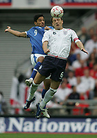 Photo: Lee Earle.<br /> England v Israel. UEFA European Championships Qualifying. 08/09/2007.England's John Terry (R) clashes with Barak Itzhaki.
