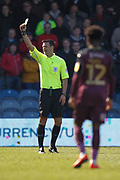 Referee Andrew Madley gives Queens Park Rangers midfielder Bright Osayi-Samuel (20) (not in picture) a yellow card during the EFL Sky Bet Championship match between Queens Park Rangers and Swansea City at the Loftus Road Stadium, London, England on 13 April 2019.