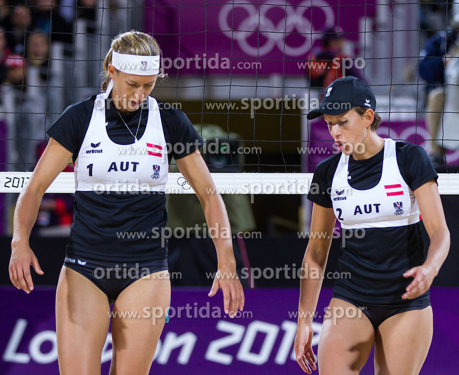 30.07.2012, Horse Ground Parade, London, GBR, Olympia 2012, Tennis, Damen Beach Volleyball, im Bild Doris und Stefanie Schwaiger (AUT)  // Doris and Stefanie Schwaiger of Austria during women Beach Volleyball at the 2012 Summer Olympics at Horse Ground Parade, London, United Kingdom on 2012/07/30. EXPA Pictures © 2012, PhotoCredit: EXPA/ Johann Groder