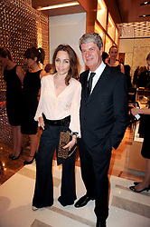 YVES CARCELLE and JEANNE MARINE at a party to celebrate the opening of the Louis Vuitton Bond Street Maison, New Bond Street, London on 25th May 2010.