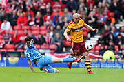 Curtis Main (#9) of Motherwell lifts the ball over the sliding challenge of Anthony O'Connor (#5) of Aberdeen during the William Hill Scottish Cup Semi-Final match between Motherwell and Aberdeen at Hampden Park, Glasgow, United Kingdom on 14 April 2018. Picture by Craig Doyle.