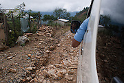 A driver passes through a collapsed road in Tilapa township, Guerrero, after a landslide, on September 29th, 2010.  (Photo: Prometeo Lucero)