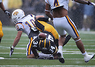 September 3, 2011: Iowa Hawkeyes running back Marcus Coker (34) fumbles the ball after a hit by Tennessee Tech Golden Eagles cornerback Taylor Hennigan (10) during the first half of the game between the Tennessee Tech Golden Eagles and the Iowa Hawkeyes at Kinnick Stadium in Iowa City, Iowa on Saturday, September 3, 2011. Iowa defeated Tennessee Tech 34-7 in a game stopped at one point due to lightning and rain.